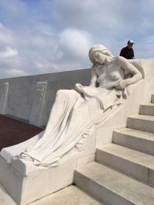 Vimy sculpture symbolizing a Canadian mother finding her son's name in a newspaper's list of war dead