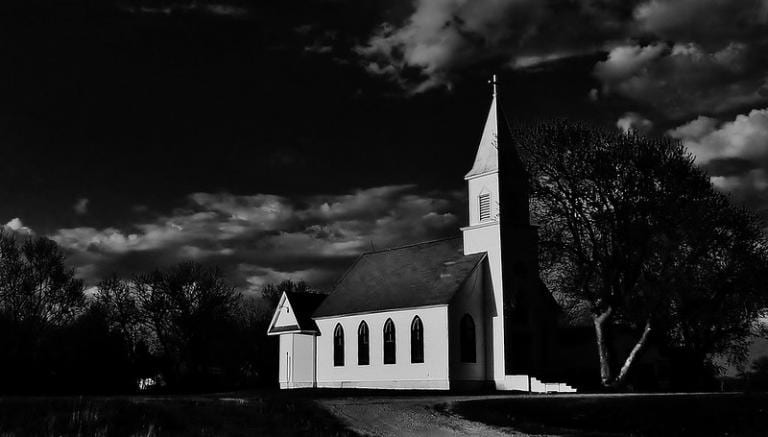 Rural Lutheran church in shadow
