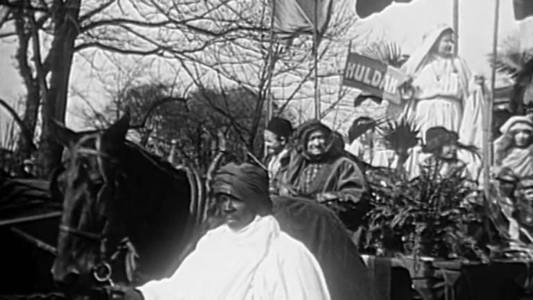 """The suffragist representing Huldah on the """"Women of the Bible Lands"""" float"""