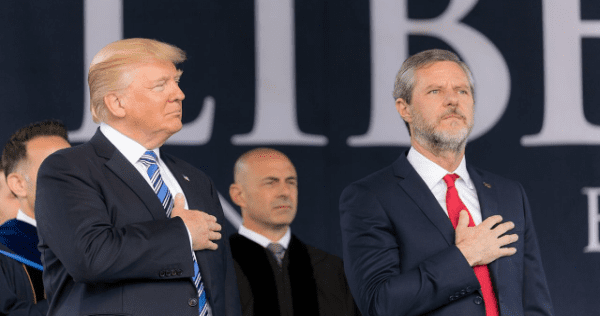 donald trump and jerry fallwell junior with hands over hearts