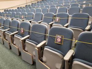 Blocked off rows of seats in a socially distanced classroom