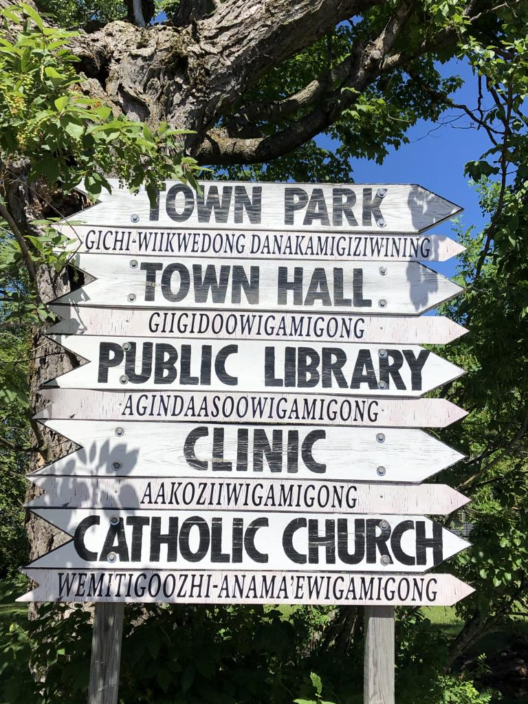 Sign in La Pointe, WI in both English and Ojibwe