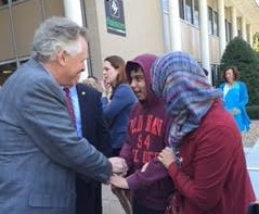 D shaking hand with Virginia Governor Terry McAuliffe