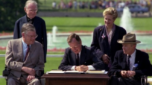 President George H.W. Bush signing the American Disabilities Act into law 25 years ago.