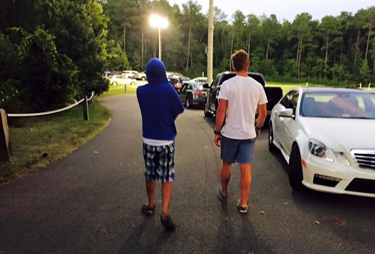 Isaiah came home from college one summer and asked D to come out and hang with him. Two friends walking.