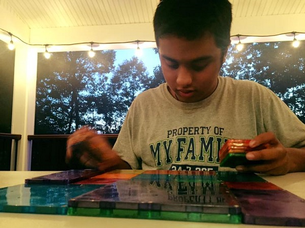 D creating magic with his Magnatiles. Architecture runs in his blood ...