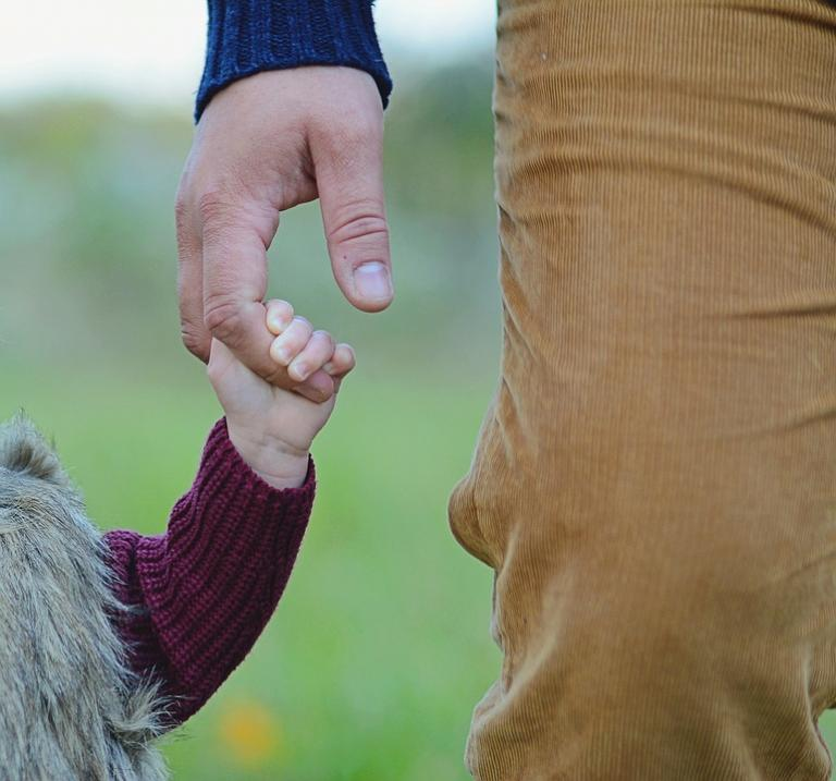 Man holding little girl's hand