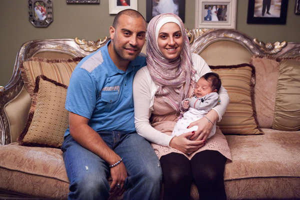 A young Muslim couple with baby