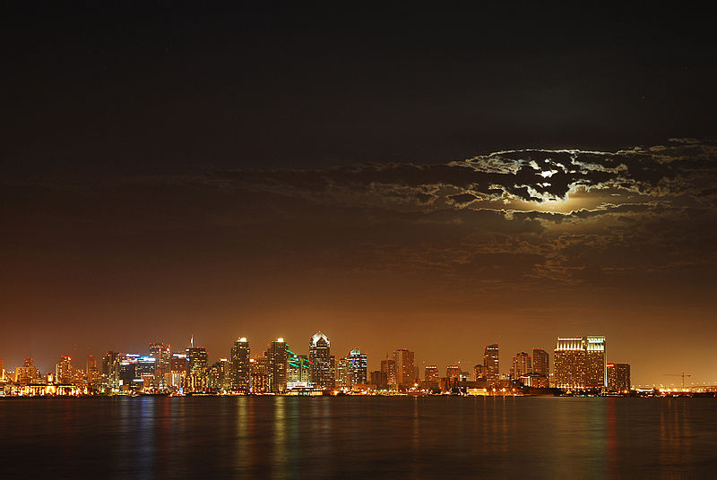 San Diego from the water with moon in clouds