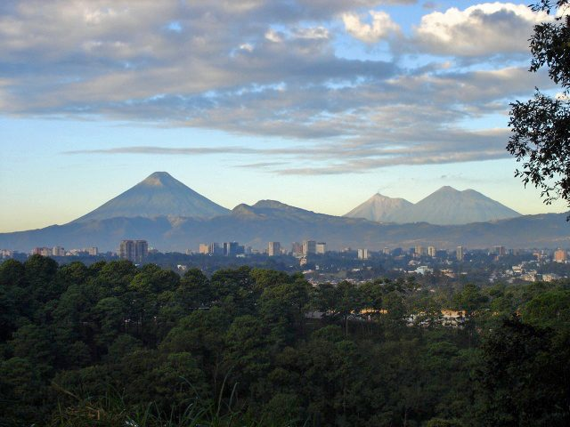 Guatemala City, with three volcanos