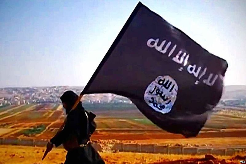 """ISIS's black flag with one of ISIS's black-hearted """"soldiers"""""""