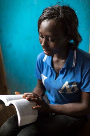 Woman (in Africa?) reads scriptures