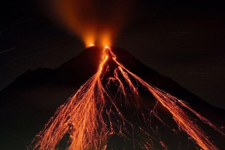 A volcanic eruption by night