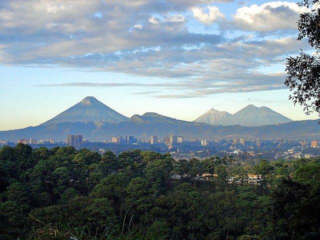 Three volcanos with Guatemala City