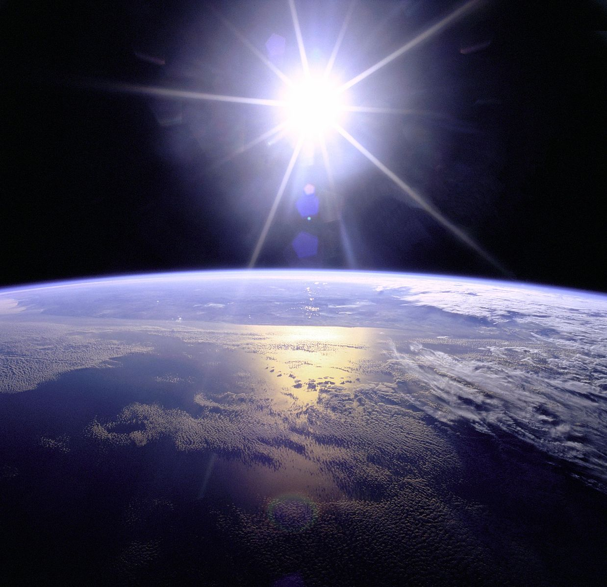 NASA shot of sunburst above the Earth