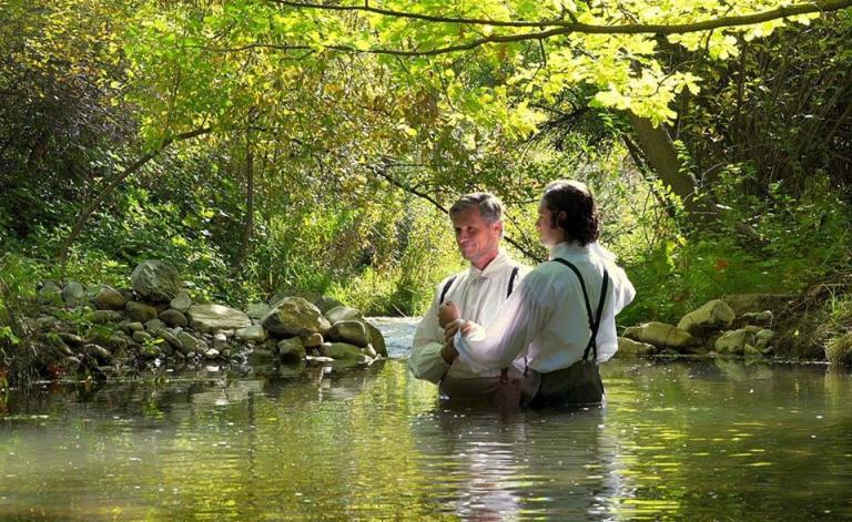 Martin Harris being baptized