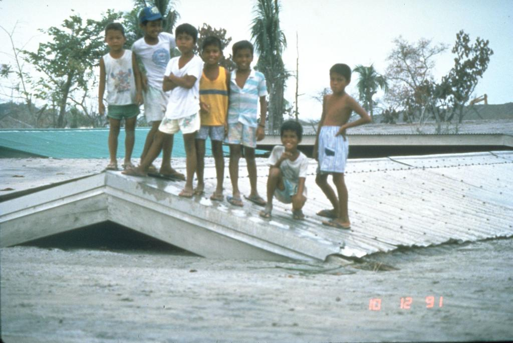 Children atop a former school's roof.