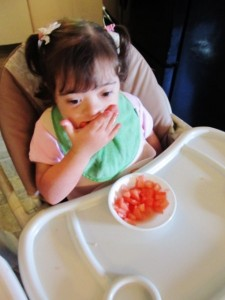 Katie was still working on feeding herself due to coordination issues. (Katie probably saw an occupational therapist)
