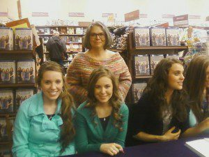 This is the photo I get the most emails claiming I used someone elses photo. Is that not clearly me behind three of the Duggar daughters? Image by Suzanne Titkemeyer used with permission by NLQ