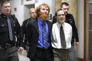 After hearing their guilty verdicts, handcuffed Old Testament prophets Esten and Timothy Ciboro smile for no reason whatsoever. Toledo Blade photo by Andy Morrison.