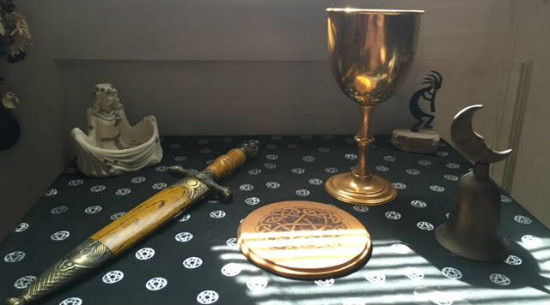My first athame and pentacle.  An early bell and chalice.