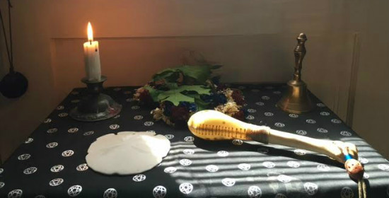 A bell for air, candle for fire, seashell for water, and a rattle for air.  Dried leaves and flower represent deity.