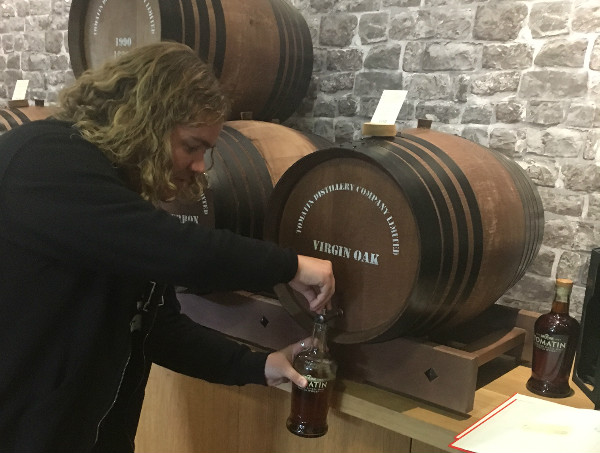 Me doing some pouring at Tomatin.  From barrel to bottle (to my mouth eventually).