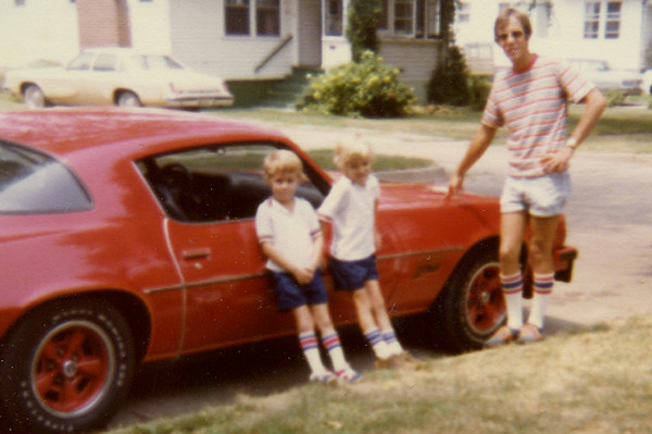 That's me in the middle with my brother and my Dad.  Tube socks were apparently a thing then.