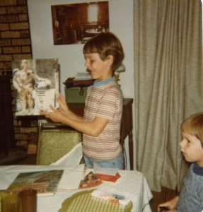 Jeffrey Overstreet at 7 years old, admiring a new Star Wars folder for school.