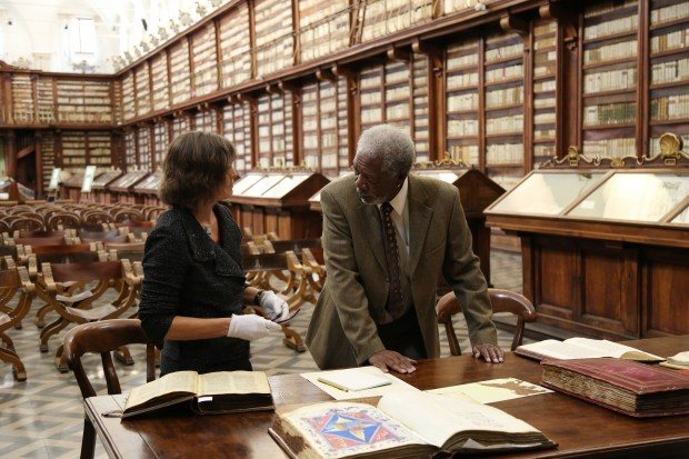 ROME - Morgan Freeman examines ancient documents with Cornell University Professor of Ancient Mediterranean Religions Kim Haines-Eitzen at the Biblioteca Casanatense in Rome, Italy.