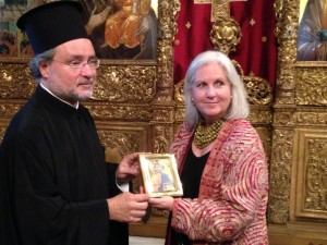 Rev. John Chryssavgis giving an icon to Terry Tempest Williams as a gift from the Patriarch Bartholomew.