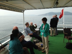 Participants keeping the conversation going as we depart from the island.