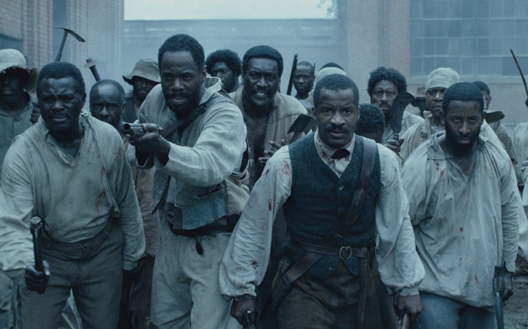 """Nate Parker, second from right, as Nat Turner in """"The Birth of a Nation"""" (Photos by Fox Searchlight Pictures)"""