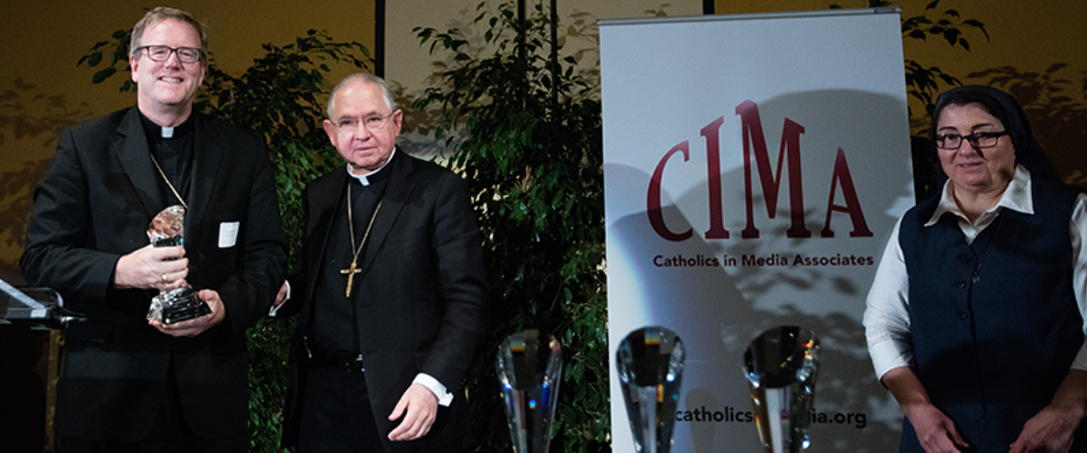 Auxiliary Bishop Robert Barron (from left), Archbishop José H. Gomez and Sister Rose Pacatte, FSP, are pictured during the 23rd annual CIMA Awards, where Bishop Barron received the CIMA Communicator Award. (photo/Victor Aléman)