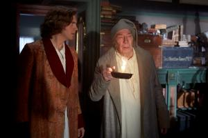 Dan Stevens (Charles Dickens); Christopher Plummer (Ebeneezer Scrooge) in The Man Who Invented Christmas