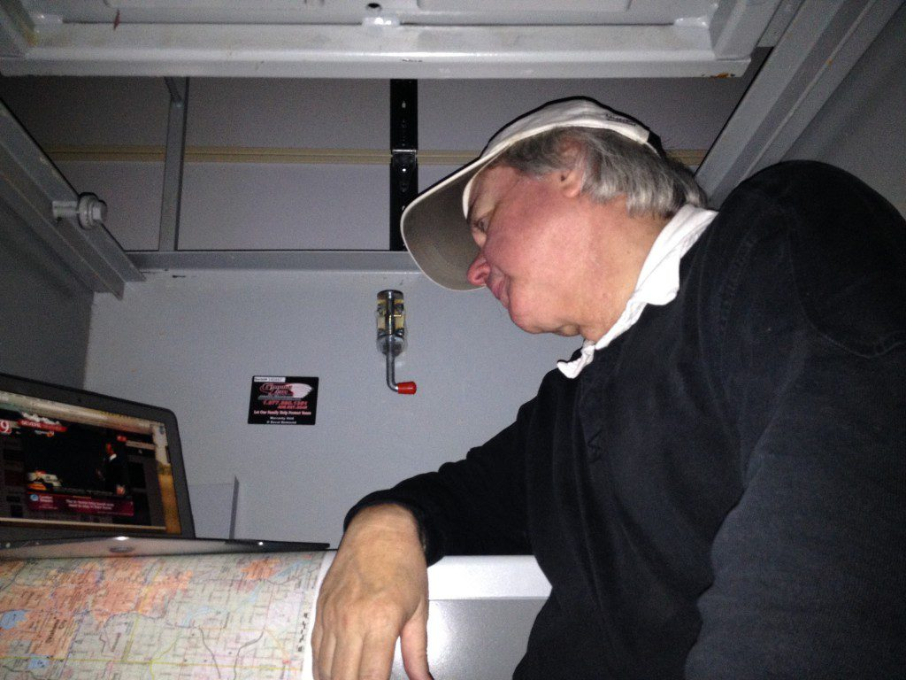 My wonderful husband, watching the storms on my computer. He's claustrophobic, so he sits on the stairs with the lid open. Copyright Rebecca Hamilton. All Rights Reserved.