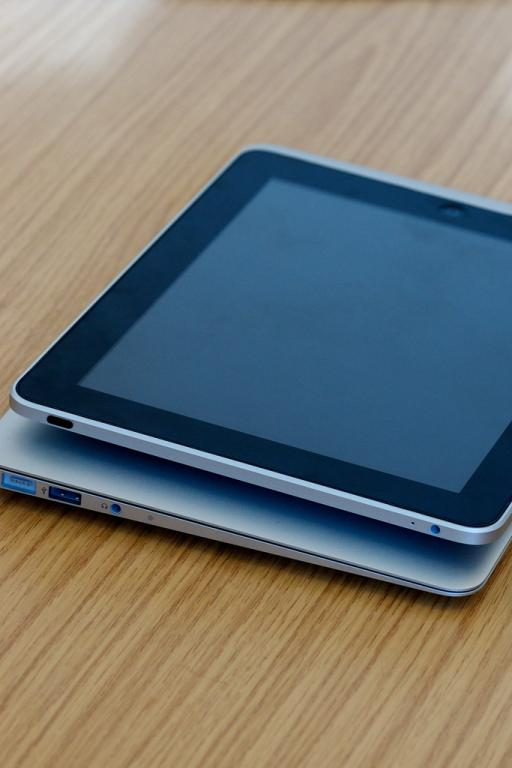 MBA 11 and iPad 1. Mine is an iPad 3 or 4, I forget which. Photo Source: Flickr Creative Commons by Paul Hudson https://www.flickr.com/photos/pahudson/