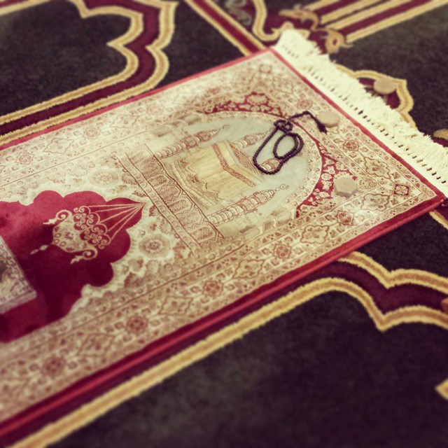 Prayer rug, beads, and turbah/Islamic Center of America/Hind Makki