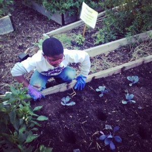 Mahasin's son Aadam Ibrahim in the garden, doing for self.