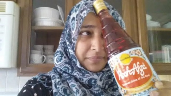 Photo of author with her beloved Rooh Afza! (Photo by Saadia Faruqi)