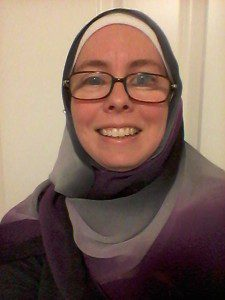 Laura P wears a hijab in the asexual pride colors. Photo by author.