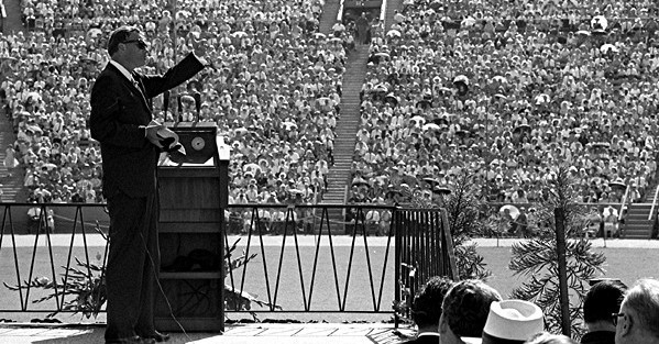 Evangelist Billy Graham preaches one Sunday to more than 40,000 worshipers at the Los Angeles Memorial Coliseum. (Edited version of a UCLA image.