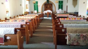 Quilts rest on the backs of pews at Peace Lutheran Church in Colfax, Washington, USA, before a special service to bless them and send them out to people in need.