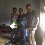Tshoper poses with two of his professors from the National Institute of Arts in Kinshasa