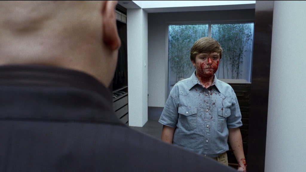 A still-traumatized Fisk stares at his younger self in the mirror.