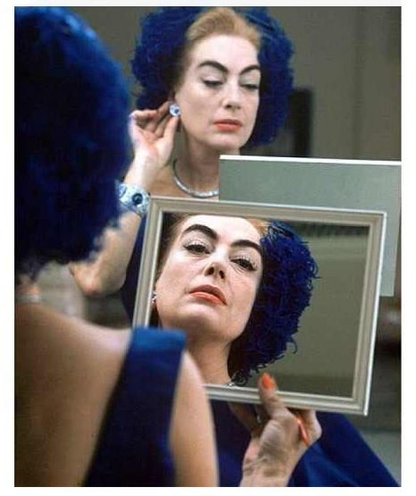 "Eve Arnold's famous picture of Joan Crawford undergoing ""construction."""