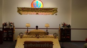 the takhat in Gurdwara Nanak Darbar and an attending priest