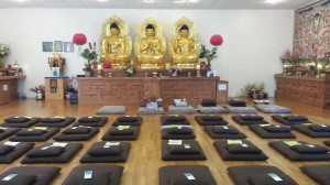 three bronze statues of the buddha