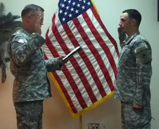 Colonel Strohm oversees Foxhole Atheist, Sergeant Justin Griffith's re-enlistment ceremony