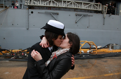 <p>Petty Officer 2nd Class Marissa Gaeta, left, kisses her girlfriend of two years, Petty Officer 3rd Class Citlalic Snell at Joint Expeditionary Base Little Creek in Virginia Beach, Va. Gaeta's ship returned from 80 days at sea on Wednesday.</p>